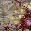 Christmas candle with winter berries, stars, beads, leaves — Stock Photo