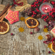 Stock Photo: Christmas candle with winter berries, stars, nuts