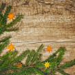 Christmas fir tree on old wooden board — Zdjęcie stockowe