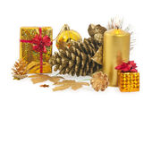 Christmas cones, candle, gift,bows and balls — Stock Photo