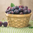 Plums in basket — Stock Photo #38957937