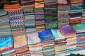 Colorful silk and woven fabric for sale in a Cambodian market — Stock Photo