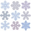 Blue snowflakes on a white background — 图库矢量图片