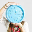 Girl with big clock — Stock Photo #24328661