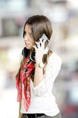 Girl calling and music — Stock Photo