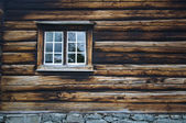 Dark timbered wooden wall with window — Stock Photo