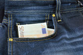Fifty evrov banknote in the pocket of dzhins — Stock Photo