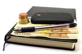 Notebook, mobile, pen, coins and banknotes — Stock Photo