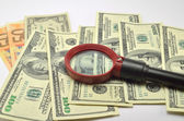 Magnifier on banknotes — Stock Photo