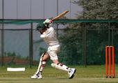 Cricket boy driving ball — Stock Photo