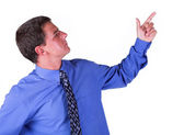Man with blue shirt pointing at something — Stock Photo