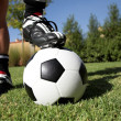 Man standing with foot on soccerball — Foto Stock