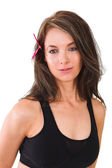 Butterfly in hair and gym clothing — Stock Photo