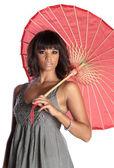 Elegant brunette holding umbrella — Stock Photo