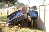 Bmw car crash though wall — Stock Photo