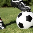 Soccerboot on top of soccer ball — Stock Photo
