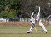 School boy playing cricket — Stock Photo