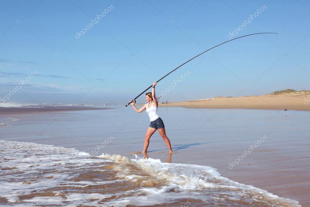 Beach lady casting fishing rod — Stock Photo © jacojvr ...
