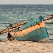Indigenous fishing boat on Mozambique beach — Stock Photo #38379945