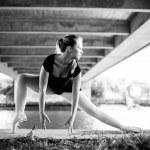 Blonde Ballerina standing under a bridge — Stock Photo #38380633