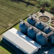 Tower silos and storage facility, aerial view - Stock Photo