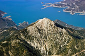 Rocky mountain top near lake, aerial view — Stock Photo