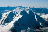 Mountain top covered in snow, aerial view — Stock Photo