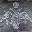 Stock Photo: Two-headed eagle carved in stone.