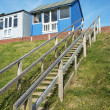 Stock Photo: Beach Huts at Sandilands