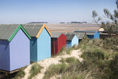 Playa de chozas en pozos próxima al mar — Foto de Stock