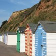 Colorful Beach Huts at Seaton - Stock Photo