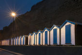 Blue and White Beach Huts at Night — Stock Photo