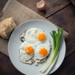 Stock Photo: Breakfast with fried eggs and spring onion