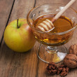 Honey, apple and walnuts — Stock Photo