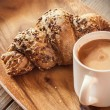 Coffee and whole wheat croissant — Stock Photo