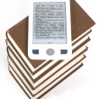 E-book on a pile of books - Stockfoto