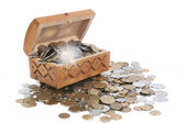 Box with coins on isolated background flare — Stock Photo