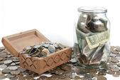 The box with coins on isolated background — Stock Photo