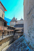 Inner yard of Chillon castle with tower and walls in inner yard. — Stock Photo