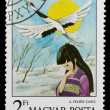 Postage stamp shows womand stork — Stock Photo #26047245