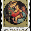 "Postage stamp shows picture Raffaello Santi ""MadonnGyermek — Stock Photo #26048023"