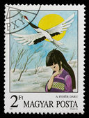 Postage stamp shows a woman and stork — Stock Photo