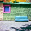 Blue bench against green wall, La Boca, Caminito, Buenos Aires A — Stock Photo