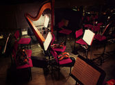 Harp and violins in orchestral pit — Stock Photo