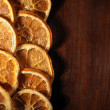 Dried orange slices on wood — Stock Photo