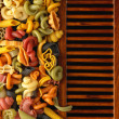Dried pastshapes on wooden slats — Stock Photo #33263209