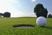 Golf hole and ball — Stock Photo