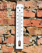 Thermometer on a brick wall — Stock Photo