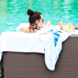 Women Relaxing Around Pool — Stock Photo #27302431