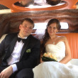 Portrait of happy newly wed couple in car — Stock Photo